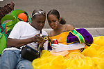 A man shows a woman a picture on the back of his camera after she took part in the ZomerCarnaval (Summer Carnival) street parade in Rotterdam, the Netherlands. The street parade is the colorful high point of the Rotterdam carnival. It is a tropical themed parade with over 2000 participants and travels 6km through the center of Rotterdam.