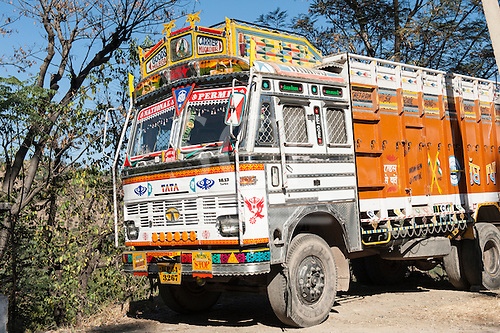 Himachal Pradesh, India. Colourful Tata truck personalised by its owner with brightly painted motifs and decorations; Dharamsala to Shimla.