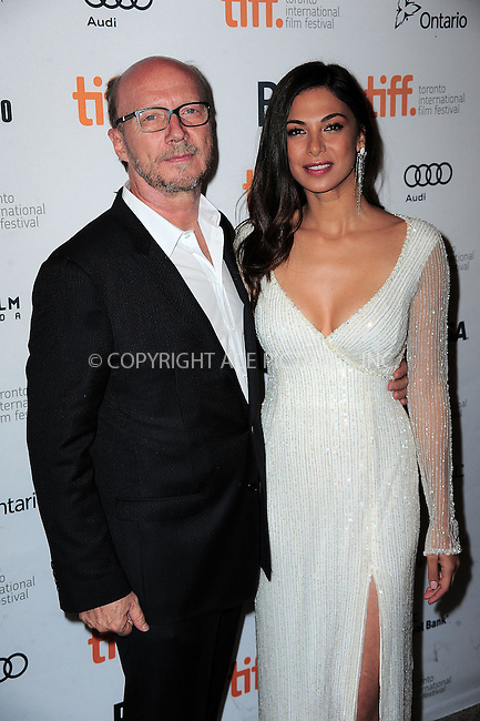 WWW.ACEPIXS.COM<br /> <br /> September 9 2013, Toronto<br /> <br /> Filmmaker Paul Haggis (L) and actress Moran Atias arriving at the 'Third Person' Premiere during the 2013 Toronto International Film Festival at The Elgin on September 9, 2013 in Toronto, Canada.<br /> <br /> By Line: William Bernard/ACE Pictures<br /> <br /> <br /> ACE Pictures, Inc.<br /> tel: 646 769 0430<br /> Email: info@acepixs.com<br /> www.acepixs.com