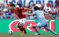 Calcio, finale di Coppa Italia: Roma vs Lazio. Roma, stadio Olimpico, 26 maggio 2013..AS Roma forward Mattia Destro, left, is challenged by Lazio defender Giuseppe Biava during the Italian Cup football final match between AS Roma and Lazio at Rome's Olympic stadium, 26 May 2013..UPDATE IMAGES PRESS/Isabella Bonotto....