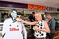 Elvis, Swansea City V Liverpool, Liberty Stadium, 13/05/12<br /> Swansea City fans dress up in Elvi costumes for the last game of the season against Liverpool after critic claimed there was more chance of spotting Elvis than the Swans staying in the Premier League. <br /> Picture by: Ben Wyeth<br /> Athena Picture Agency<br /> info@athena-pictures.com