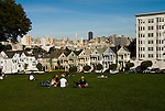 California: San Francisco. People relaxing in Alamo Square with view of Victorians and modern downtown. Photo copyright Lee Foster. Photo #: san-francisco-alamo-square-20-casanf77505