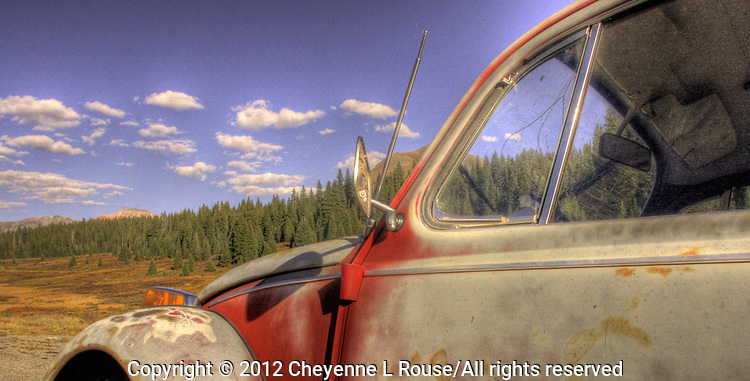 Abandoned Volkswagon Bug on Lizard Head Pass near Telluride Colorado in the fall.
