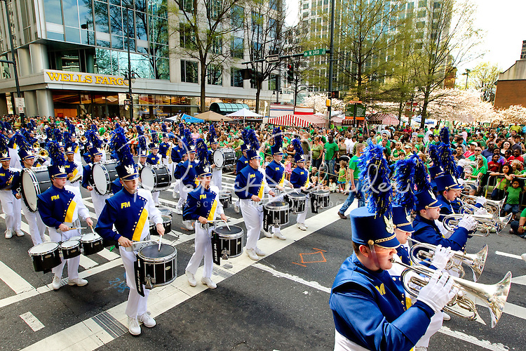 Photography of the Charlotte NC St. Patrick's Day Parade in March 2012. Image shows members of the Fort Mill High School Band  performing in the parade along Tryon Street. Photography is part of a series of St. Patrick's Day Parade photos in Charlotte, NC.