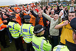 Wealdstone 0 Newport County 0, 17/03/2012. St Georges Stadium, FA Trophy Semi Final. Visiting supporters confronting opposition fans on the pitch at St Georges Stadium, home ground of Wealdstone FC, as the club played host to Newport County (yellow) in the semi-final second leg of the F.A. Trophy. The game ended in a goalless draw, watched by a capacity crowd of 2,092 which meant the visitors from Wales progressed by three goals to one to the competition's final at Wembley, where they would meet York City. The F.A. Trophy was the premier cup competition for non-League clubs in England and Wales affiliated to the Football Association. Photo by Colin McPherson.