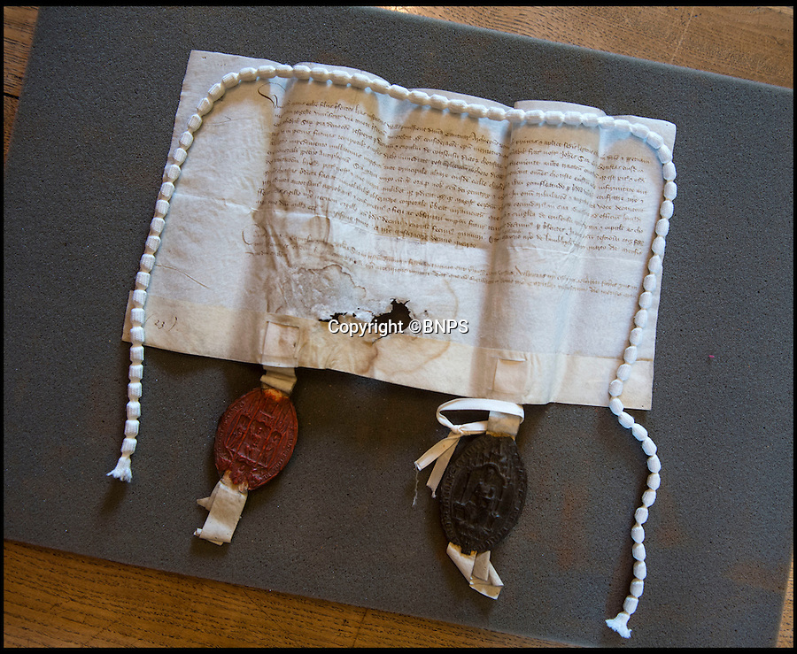 BNPS.co.uk (01202 558833)<br /> Pic: PhilYeomans/BNPS<br /> <br /> Another 600 year old latin document from William, Archbishop of Canterbury to the Dean of salisbury about the Choristers. dated May 1395.<br /> <br /> Latin scholar unearths ecclesiastical treasure's from the vault.<br /> <br /> Salisbury cathedral has recruited a new latin expert to decipher its precious collection of historic manuscripts which have remained unexamined for decades.<br /> <br /> Helen Sumping, 27, is working her way through thousands of documents that date back as far as 1136 at Salisbury Cathedral in Wiltshire, to uncover the secrets of the famous landmark.<br /> <br /> While some of the most important papers have had brief summaries written before, many of the documents have not been touched for centuries due to the difficulty of reading the handwritten script.<br /> <br /> The entire archive has not been worked on since the 1930s and Helen is now delving into the past to catalogue papers up to 880 years old and make the collection more accessible to the public.