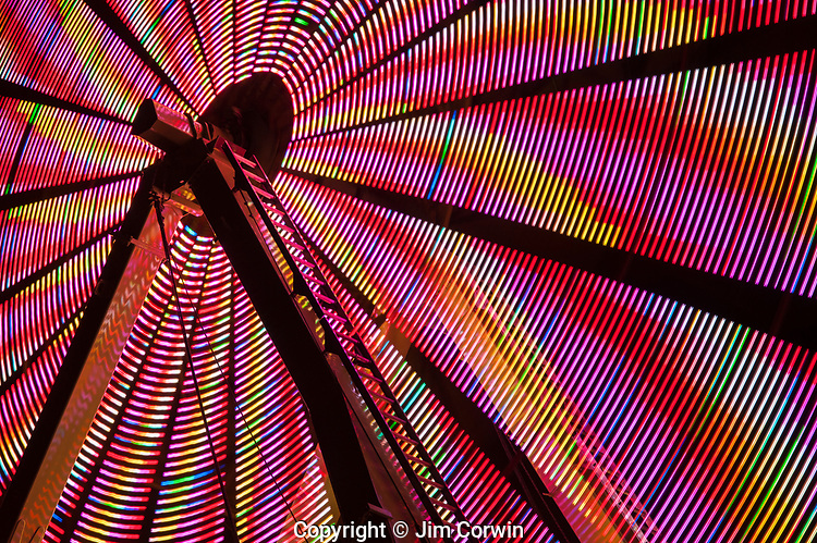 Ferris wheel in motion with multi colors and abstract patterns of colors