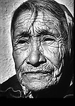 A Lakota woman seen waiting at a bus stop on the Pine Ridge Lakota Reservation in South Dakota in 1981.