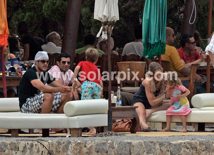 **EXCLUSIVE PICTURES FROM SOLARPIX.COM**.**WORLDWIDE SYNDICATION RIGHTS EXCLUDING SPAIN & PORTUGAL****NO SPAIN & PORTUGAL**.Inter Milan superstar footballer Luis Figo was in Ibiza with his model wife Helen Swedin this weekend. The wealthy couple met up with friends and had a couple of beers and a spot of lunch at a popular beach bar before heading off back to their private villa in the hills..JOB REF:   9084     MAD       DATE:   24.05.09.**MUST CREDIT SOLARPIX.COM OR DOUBLE FEE WILL BE CHARGED**.**NO ONLINE USAGE BEFORE FEE AGREED**.**CALL SOLARPIX : +34 952 811 768 or LOW RATE FROM UK 0844 617 7637**