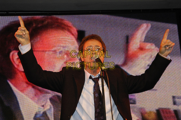 "CLIFF RICHARD.At HMV Oxford Circus, London..Launch of his new single ""What Car"" with a free performance and signing..May 9th, 2005.half length live gig glasses singing hands pointing gesture.www.capitalpictures.com.sales@capitalpictures.com.©Capital Pictures"