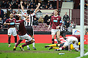 HEARTS' MARIUS ZALIUKAS CAN'T BELIEVE HE'S JUST KNOCKED THE BALL INTO HIS OWN NET FOR ST MIRREN'S EQUALISER