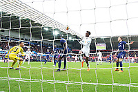 Tammy Abraham of Swansea lines up a header as he finds himself in free space in the box as Michel Vorm of Tottenham Hotspur watches on during the Fly Emirates FA Cup Quarter Final match between Swansea City and Tottenham Hotspur at the Liberty Stadium, Swansea, Wales, UK. Saturday 17 March 2018
