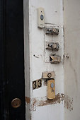 Doorbells on a privately rented house in multiple occupation, Camden Town, London