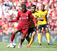 Liverpool's Georginio Wijnaldum shields the ball from Wolverhampton Wanderers' Jonny<br /> <br /> Photographer Rich Linley/CameraSport<br /> <br /> The Premier League - Liverpool v Wolverhampton Wanderers - Sunday 12th May 2019 - Anfield - Liverpool<br /> <br /> World Copyright © 2019 CameraSport. All rights reserved. 43 Linden Ave. Countesthorpe. Leicester. England. LE8 5PG - Tel: +44 (0) 116 277 4147 - admin@camerasport.com - www.camerasport.com