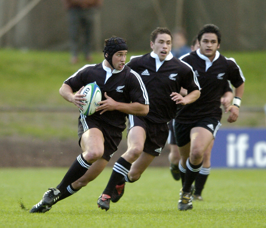 Photo. Jed Wee..England U21 v New Zealand U21, IRB U21 World Championship, 11/06/2004..New Zealand's Luke McAllister (L).
