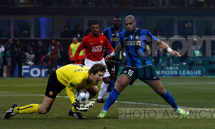 Manchester United's Edwin Van Der Sar saves at the feet of Inter Milan's Adrianno