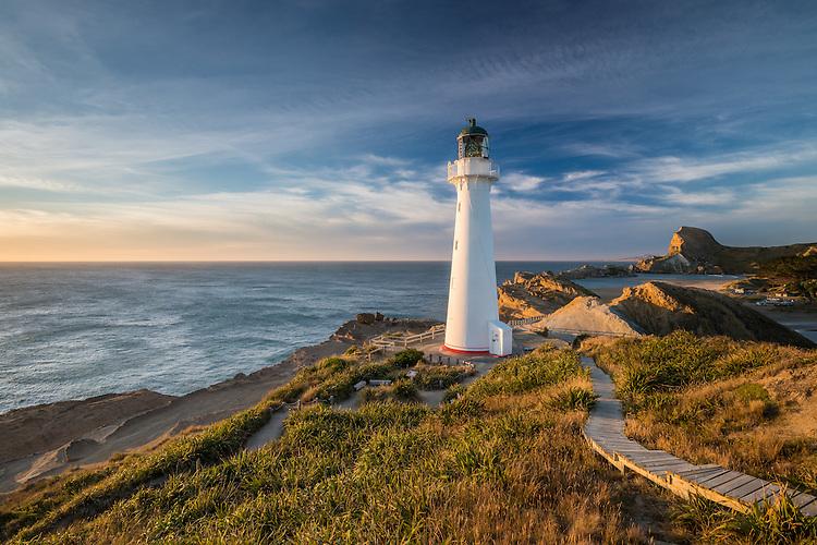New Zealand landscape photography - Castlepoint lighthouse at sunrise, looking towards Castle Rock, Coastal Wairarapa