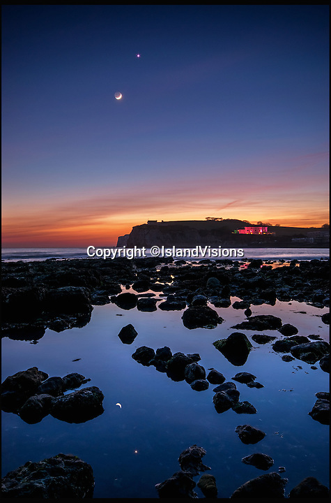 BNPS.co.uk (01202 558833)<br /> Pic: IslandVisions/BNPS<br /> <br /> Stellar show...<br /> <br /> Magical celestial show featuring the Moon and Venus in close proximity was captured by IOW photographer Jamie Russell over Freshwater Bay last night. It might be the last such sighting for some time as wind and rain are predicted for the week ahead.