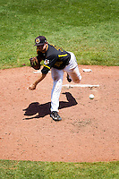 Albert Minnis (33) of the Wichita State Shockers delivers a pitch during a game against the Missouri State Bears in the 2012 Missouri Valley Conference Championship Tournament at Hammons Field on May 23, 2012 in Springfield, Missouri. (David Welker/Four Seam Images).