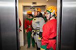 © Joel Goodman - 07973 332324 . 7 December 2013 . The lift doors close as Batman ( PAUL SWEENEY , 43 from Worsley - correct ) and elves receive their briefing ahead of their descent . In scenes reminiscent of a Fathers for Justice demonstration , people in superhero and Christmas-themed costumes , abseil 107 metres down the New York Street side of City Tower to raise money for the Factory Youth Zone in Harpurhey . Photo credit : Joel Goodman
