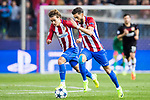 Antoine Griezmann (l) and Yannick Ferreira Carrasco of Atletico de Madrid in action during their 2016-17 UEFA Champions League Round of 16 second leg match between Atletico de Madrid and Bayer 04 Leverkusen at the Estadio Vicente Calderon on 15 March 2017 in Madrid, Spain. Photo by Diego Gonzalez Souto / Power Sport Images