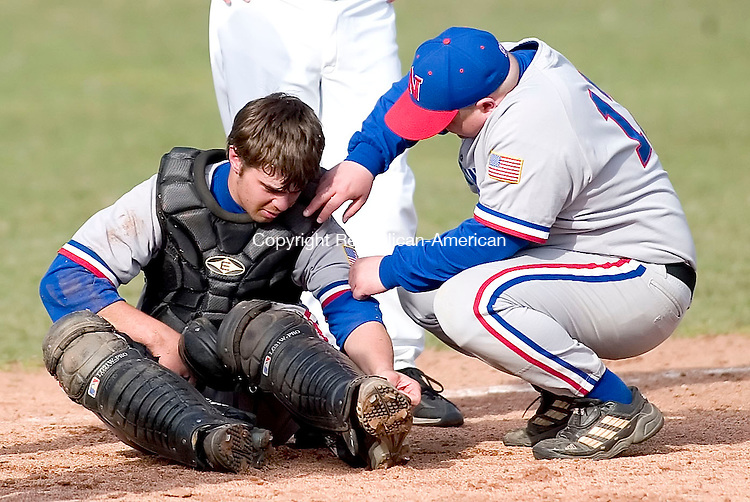 WOODBURY, CT- 11 APRIL 07- 041107JT15- <br /> Nonnewaug catcher Greg Carlson and coach Toby Denman assess the damage after Carlson collided with a Thomaston player as he came in to home for a run at Wednesday's game at Nonnewaug.<br /> Josalee Thrift Republican-American