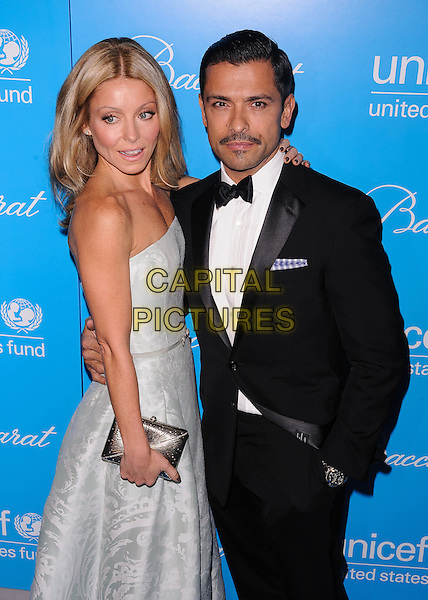 Kelly Ripa, Mark Consuelos.Eighth Annual UNICEF Snowflake Ball.', New York, New York, USA..November 27th, 2012.half length silver strapless dress white shirt black tuxedo married husband wife side clutch bag.CAP/ADM/MSA.©Mario Santoro/AdMedia/Capital Pictures.
