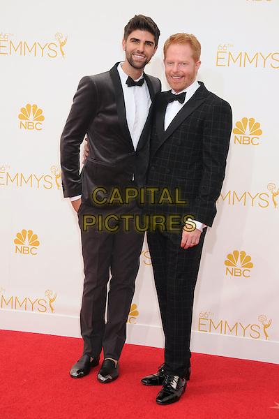 25 August 2014 - Los Angeles, California - Justin Mikita, Jesse Tyler Ferguson. 66th Annual Primetime Emmy Awards - Arrivals held at Nokia Theatre LA Live. <br /> CAP/ADM/BP<br /> &copy;BP/ADM/Capital Pictures