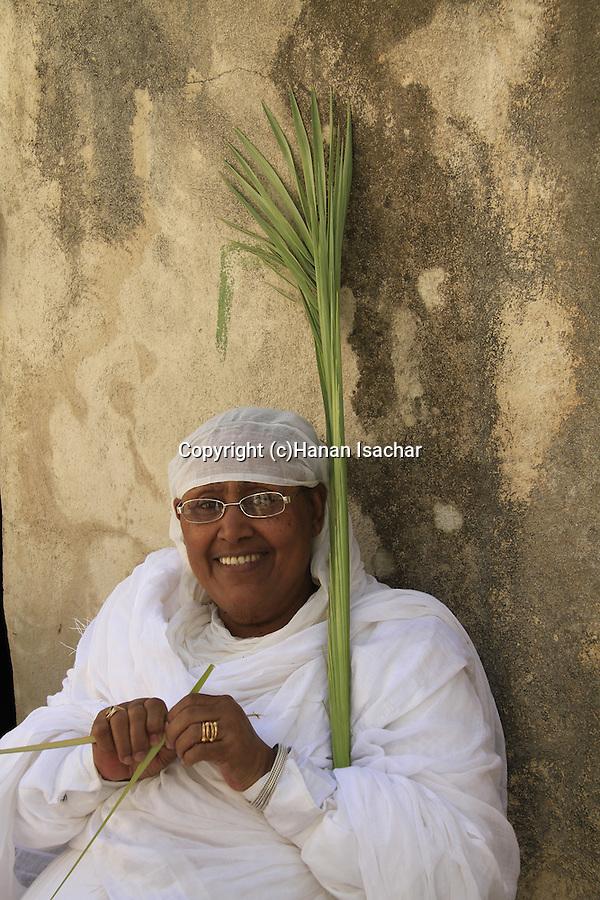 Israel, Jerusalem, Ethiopian Orthodox Pilgrim celebrates Palm Sunday at the Church of the Holy Sepulchre