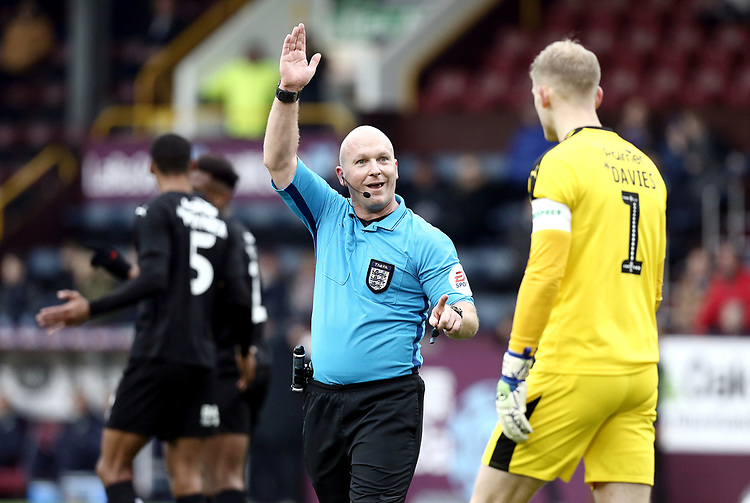Referee Simon Hooper gestures to Barnsley's Adam Davies after reversing his penalty decision when a VAR referral showed Burnley's Matej Vydra was off-side<br /> <br /> Photographer Rich Linley/CameraSport<br /> <br /> Emirates FA Cup Third Round - Burnley v Barnsley - Saturday 5th January 2019 - Turf Moor - Burnley<br />  <br /> World Copyright © 2019 CameraSport. All rights reserved. 43 Linden Ave. Countesthorpe. Leicester. England. LE8 5PG - Tel: +44 (0) 116 277 4147 - admin@camerasport.com - www.camerasport.com