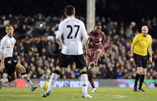 10.12.2012 London, England. Shola Ameobi of Newcastle shoots during the Premier League game between Fulham and Newcastle United from Craven Cottage.