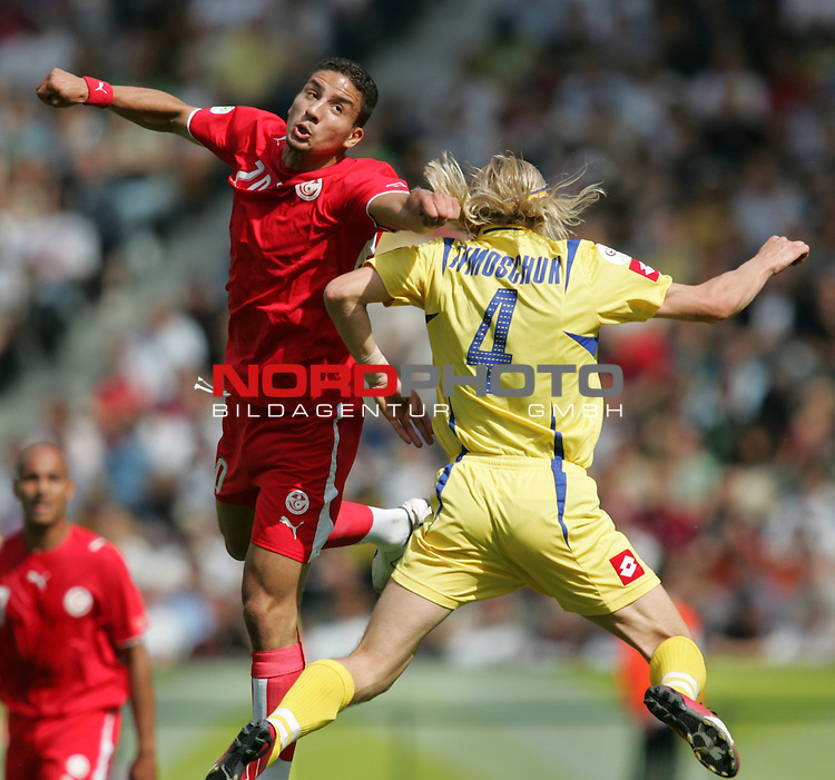 FIFA WM 2006 - Gruppe H ( Group H )<br /> Play #48 (23-Jun) - Ukraine vs Tunisia.<br /> Anatoliy Tymoschuk (r) from Ukraine and Hamed Namouchi (l) from Tunisia fight for the ball during the match of the World Cup in Berlin.<br /> Foto &copy; nordphoto