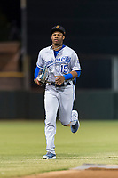 Surprise Saguaros center fielder Khalil Lee (15), of the Kansas City Royals organization, jogs off the field between innings of an Arizona Fall League game against the Scottsdale Scorpions at Scottsdale Stadium on October 15, 2018 in Scottsdale, Arizona. Surprise defeated Scottsdale 2-0. (Zachary Lucy/Four Seam Images)