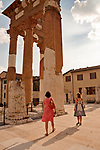 Tourists walk through the Capitolium, or Capitoline Temple, which is part of the Roman Museum in Brescia, Italy