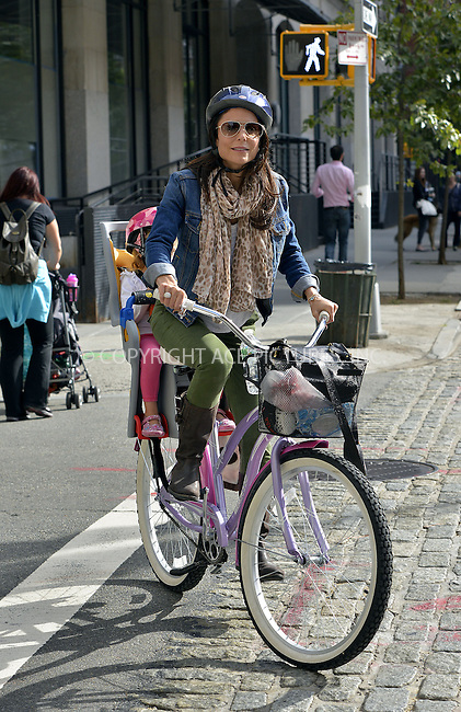 WWW.ACEPIXS.COM<br /> <br /> September 25 2013, New York City<br /> <br /> TV personality Bethenny Frankel picks up her daughter Bryn Hoppy on a bicycle on September 25 2013 in New York City<br /> <br /> By Line: Curtis Means/ACE Pictures<br /> <br /> <br /> ACE Pictures, Inc.<br /> tel: 646 769 0430<br /> Email: info@acepixs.com<br /> www.acepixs.com