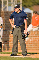 Home plate umpire Jeff Morrow between innings of the Appalachian League contest between the Kingsport Mets and the Johnson City Cardinals at Howard Johnson Field in Johnson City, TN, Thursday July 3, 2008.
