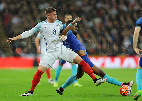 29.03.2016. Wembley Stadium, London, England.  International Football Friendly England versus Netherlands. England Midfielder Ross Barkley puts in a tackle on Netherlands Defender Riechedly Bazoer