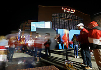 Ohio State Buckeyes and Wisconsin Badgers fans stream into Lucas Oil Stadium prior to the Big Ten championship football game in Indianapolis on Dec. 2, 2017. [Adam Cairns / Dispatch]