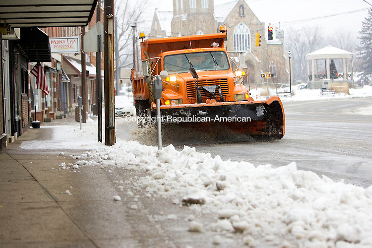 WATERBURY, CT- 01 JAN 2008- 010108JT06-<br /> A Thomaston Public Works plow clears Main Street in downtown Thomaston on Tuesday, New Year's Day.<br /> Josalee Thrift / Republican-American