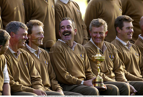The European Captain SAM TORRANCE shares a joke with his team mates, 34th Ryder Cup, The Belfry, Sutton Coldfield, 020925. Photo: Glyn Kirk/Action Plus...Golf 2002.Player players.captains.team teams group groups.portrait.trophy trophies.......................