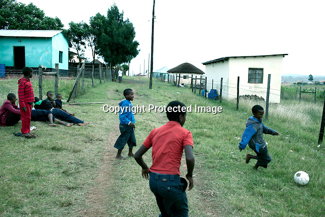 QUNU SOUTH AFRICA - MARCH 28: Boys play soccer on March 28, 2012 in Qunu, South Africa. Nelson Mandela was born in a rural village called Mvezo in 1918 and he moved to nearby Qunu as a young boy. Mvezo is about 32 kilometers away. (Photo by Per-Anders Pettersson)