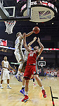 SIOUX FALLS, SD - MARCH 9: James Hunter #50 of USD, Connor DeVine #30 and Reed Tellinghuisen #23 of SDSU fight for the ball in the first half of their semi-final round Summit League Championship Tournament game Monday evening at the Denny Sanford Premier Center in Sioux Falls, SD. (Photo by Dick Carlson/Inertia)