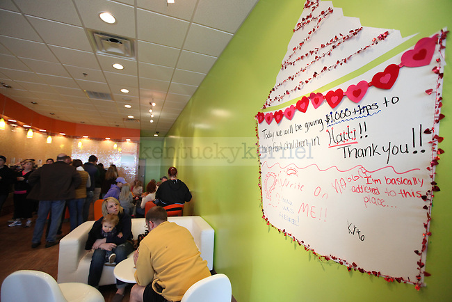 Customers line up for a Sunday afternoon treat at Orange Leaf, a self serve frozen yogurt story. Photo by Britney McIntosh | Staff