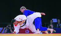 Wales' Mark Shaw (wearing blue) during his victory in the men's +100kg preliminary round of 16 contest against Samoa's Derek Sua<br /> <br /> Photographer Chris Vaughan/CameraSport<br /> <br /> 20th Commonwealth Games - Day 3 - Saturday 26th July 2014 - Judo - SECC - Glasgow - UK<br /> <br /> © CameraSport - 43 Linden Ave. Countesthorpe. Leicester. England. LE8 5PG - Tel: +44 (0) 116 277 4147 - admin@camerasport.com - www.camerasport.com