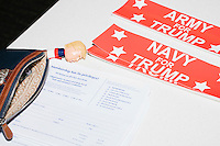 A talking pen featuring the likeness of Donald Trump lays on a table near bumper stickers and membership registration forms in the Palm Beach Republican Club and West Palm Beach Victory Headquarters office in West Palm Beach, Florida. The office serves as a place for volunteers to gather and organize for various Republican campaigns, including Donald Trump's general election campaign.