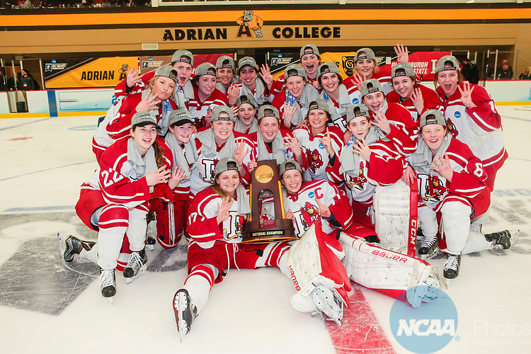 ADRIAN, MI - MARCH 18: The Plattsburgh State team pose for photos with the championship trophy after winning the Division III Women's Ice Hockey Championship held at Arrington Ice Arena on March 19, 2017 in Adrian, Michigan. Plattsburgh State defeated Adrian 4-3 in overtime to repeat as national champions for the fourth consecutive year. by Tony Ding/NCAA Photos via Getty Images)