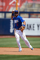 Tulsa Drillers shortstop Luis Mateo (3) throws to first during a game against the Midland RockHounds on June 3, 2015 at Oneok Field in Tulsa, Oklahoma.  Midland defeated Tulsa 5-3.  (Mike Janes/Four Seam Images)