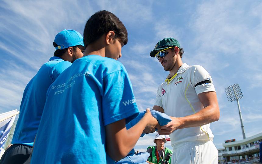 Australia's Mitchell Starc presenting blue caps to children on Cricket United Day<br /> <br /> Photographer Ashley Western/CameraSport<br /> <br /> International Cricket - Investec Ashes Test Series 2015 - Fifth Test - England v Australia - Day 3 - Saturday 22nd August 2015 - Kennington Oval - London<br /> <br /> &copy; CameraSport - 43 Linden Ave. Countesthorpe. Leicester. England. LE8 5PG - Tel: +44 (0) 116 277 4147 - admin@camerasport.com - www.camerasport.com