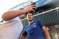 Eden Hazard of Chelsea arrives and takes time to pose for photos with young supporters during the U23 Premier League 2 match between Chelsea and Everton at the EBB Stadium, Aldershot, England on 25 August 2017. Photo by Andy Rowland.