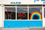 Swansea, UK, 11th May 2020.<br />Thank you NHS sign on the still closed Fortes Ice Cream Parlour in Limeslade, Swansea this morning as the devolved Welsh government continue to ask people in Wales to stay at home due to the Coronavirus pandemic.